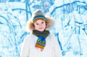 Funny boy playing outside on a sunny winter day — Stock Photo