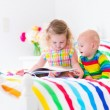 Two kids reading a book in bed — Stock Photo #53551527
