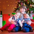 Children under a Christmas tree — Stock Photo #53996155