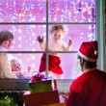 Kids looking at Santa on Christmas Eve — Stock Photo #53996231