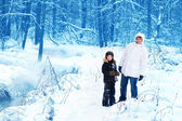 Father and son in a snowy park — Stock Photo