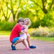 Brother and sister in a park — Stock Photo #54834889
