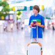 Boy traveling by airplane — Stock Photo #55276981