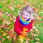 Little girl in an autumn park — Stock Photo #56943107