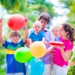 Family with kids at birthday party — Stock Photo #56943447