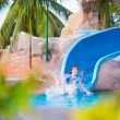 Child on water slide — Stock Photo #56943557