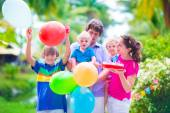 Family with kids at birthday party — Stock Photo