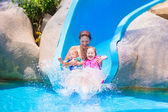 Mother and kids at water slide — Foto de Stock