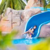 Children on water slide — Stock Photo