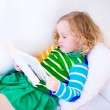 Little girl reading a book — Stock Photo #58162597