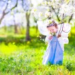 Little girl in cherry garden — Stock Photo #58281487
