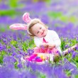 Little girl at easter egg hunt — Stock Photo #58281687