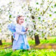 Little girl in apple garden — Stock Photo #58281731