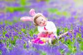 Little girl at easter egg hunt — Stock Photo