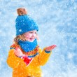 Little girl catching snow flakes — Stock Photo #58699931