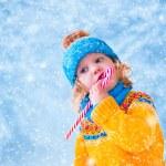 Little girl in snowy park — Stock Photo #58699943