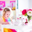 Little girl at tea party — Stock Photo #58724475