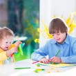 Children painting Easter crafts — Stock Photo #62563717