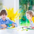 Children painting Easter crafts — Stock Photo #62563757