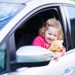 Little girl in a car — Stock Photo #62568429