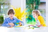 Children painting Easter crafts — Foto de Stock