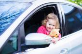 Little girl in a car — Stock Photo