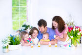 Family having breakfast on Easter day — Stockfoto