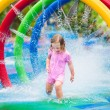 Little girl playing with fountain — Stock Photo #63975329