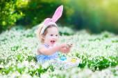 Little girl on Easter egg hunt — Stock Photo