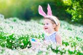Little girl at Easter egg hunt — Stock Photo