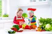 Children preparing healthy vegetable lunch — Stock Photo