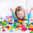 Little girl playing with toy blocks — Fotografia Stock  #65820565