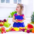 Little girl eating water melon — Stock Photo #65820717