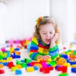 Little girl playing with toy blocks — Fotografia Stock  #67092309