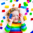 Little girl playing with toy blocks — Fotografia Stock  #67092395
