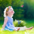 Little girl playing with a butterfly — Stock Photo #67092409