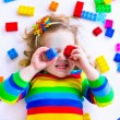 Little girl playing with toy blocks — Fotografia Stock  #67092647