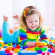 Little girl playing with toy blocks — Stock Photo #67092805