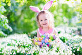 Little girl at Easter egg hunt — Photo