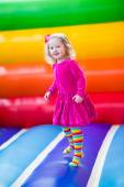 Little girl jumping and bouncing — Stock Photo