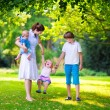 Mother and children in a park — Stock Photo #69957921