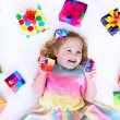 Little girl with birthday presents — Stock Photo #69957975