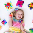 Little girl with birthday presents — Stock Photo #69958003