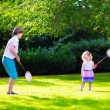 Kids playing badminton — Stock Photo #69958027