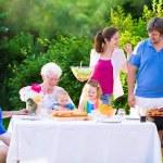 Big happy family enjoying bbq grill in the garden — Stock Photo #69958109