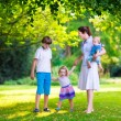 Mother and children in a park — Stock Photo #69958139