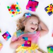 Little girl with birthday presents — Stock Photo #69958163