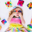 Little girl with birthday presents — Stock Photo #69958211