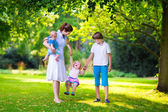 Mother and children in a park — Stock Photo