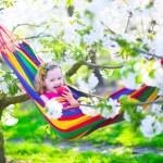 Little girl relaxing in a hammock — Stock Photo #70741961